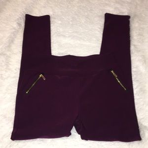 Burgundy leggings with gold zippers